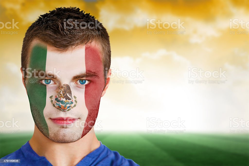 Mexico football fan in face paint stock photo