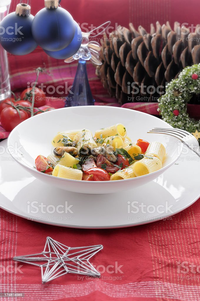 Mezze Maniche with pecorino cheese, pepper, mussels and cherry tomatoes royalty-free stock photo