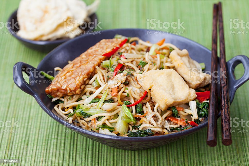 Mi goreng, mee goreng Indonesian cuisine, spicy stir fried noodles stock photo