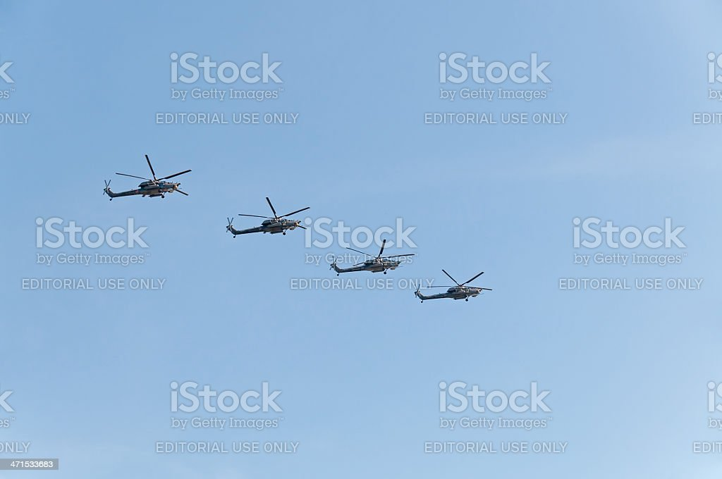 Mi-28 (Havoc) attack helicopters fly against blue sky background royalty-free stock photo