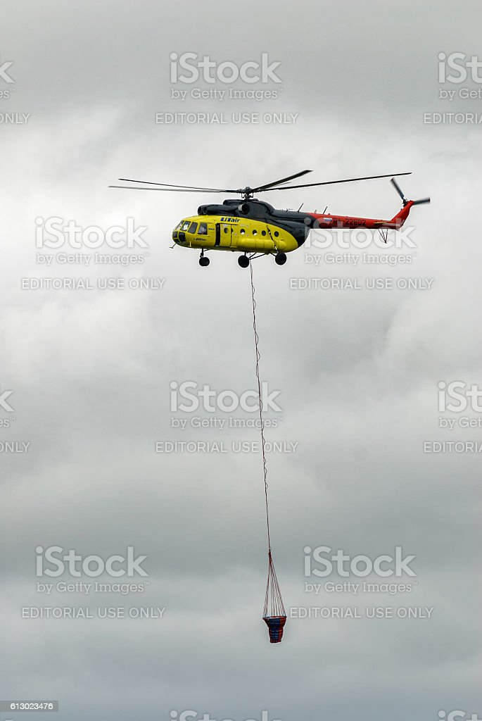 Mi-8 helicopter with antifire tank stock photo