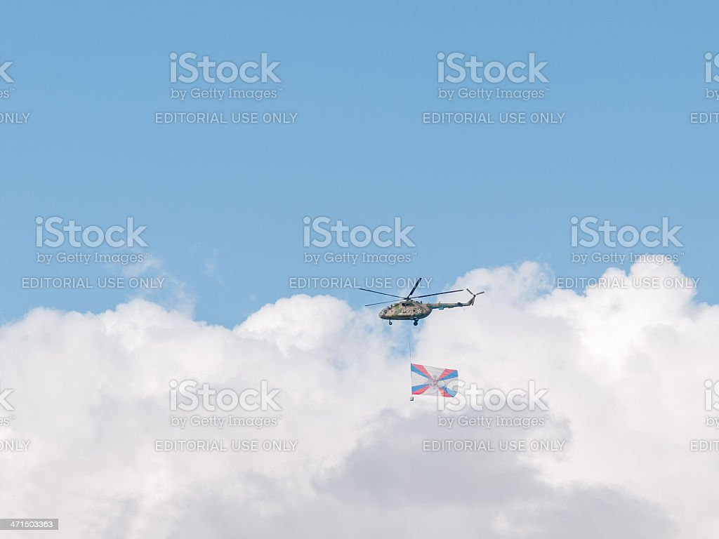Mi-8 helicopter with Ministry of Defense flag against sky background royalty-free stock photo