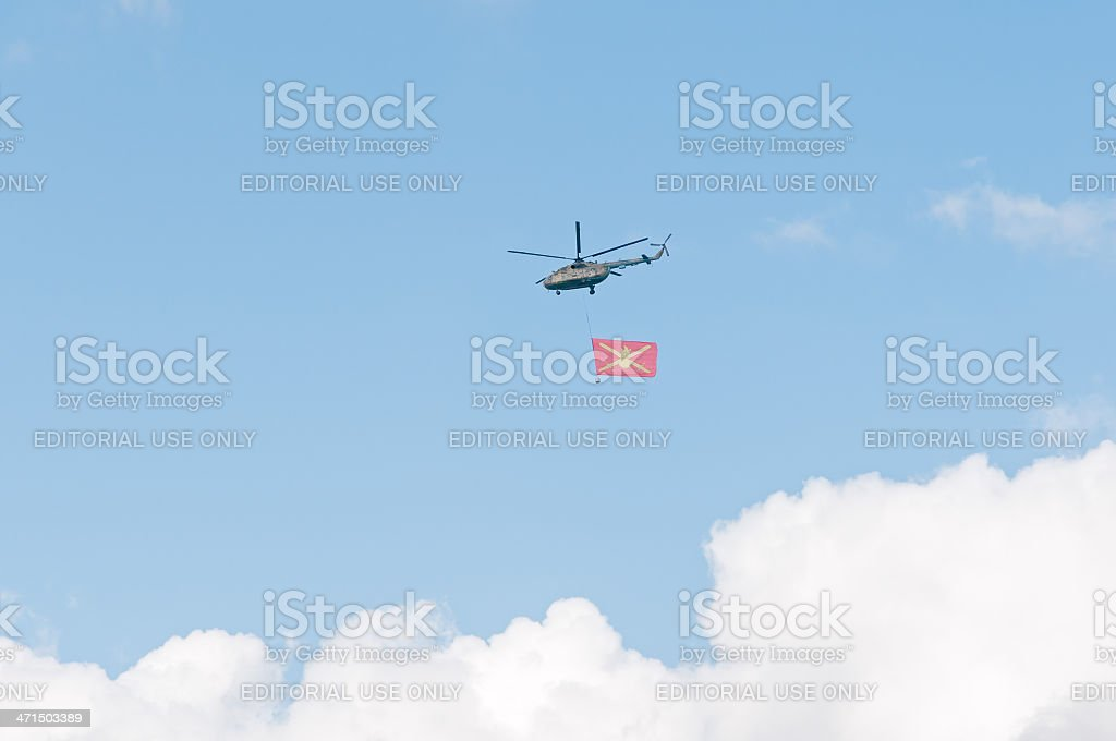 Mi-8 helicopter with Russian Ground Forces flag against sky background royalty-free stock photo