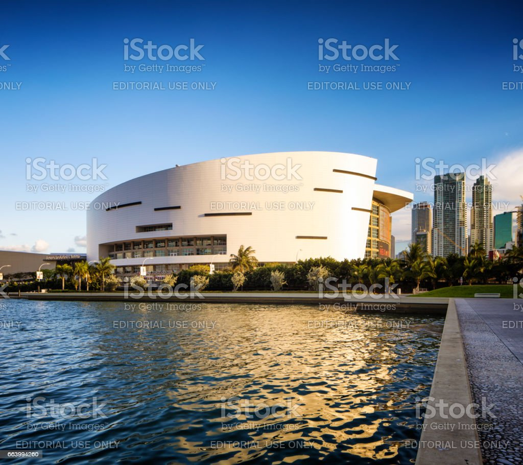 Miami American Airlines stadium side view with canal and reflection at sunset stock photo
