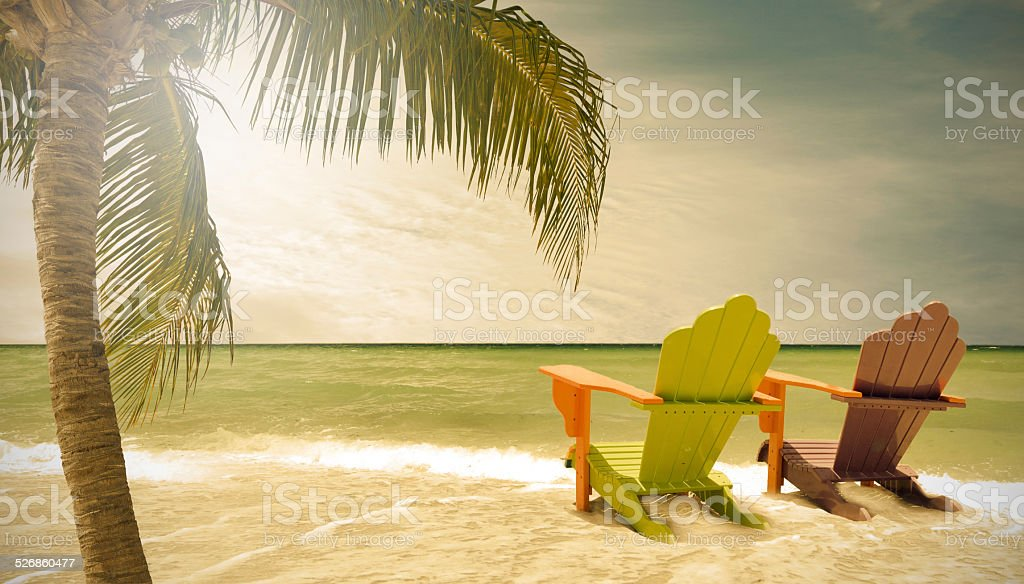 Miami Beach Florida, lounge chairs and palm trees stock photo
