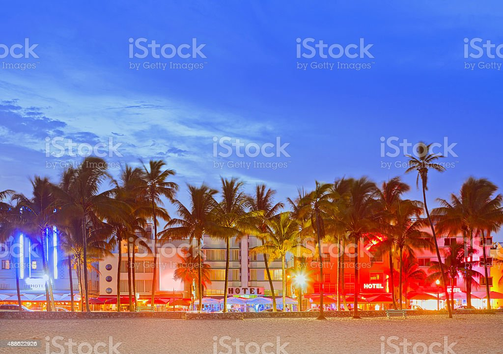 Miami Beach Florida, sunset over illuminated skyline stock photo