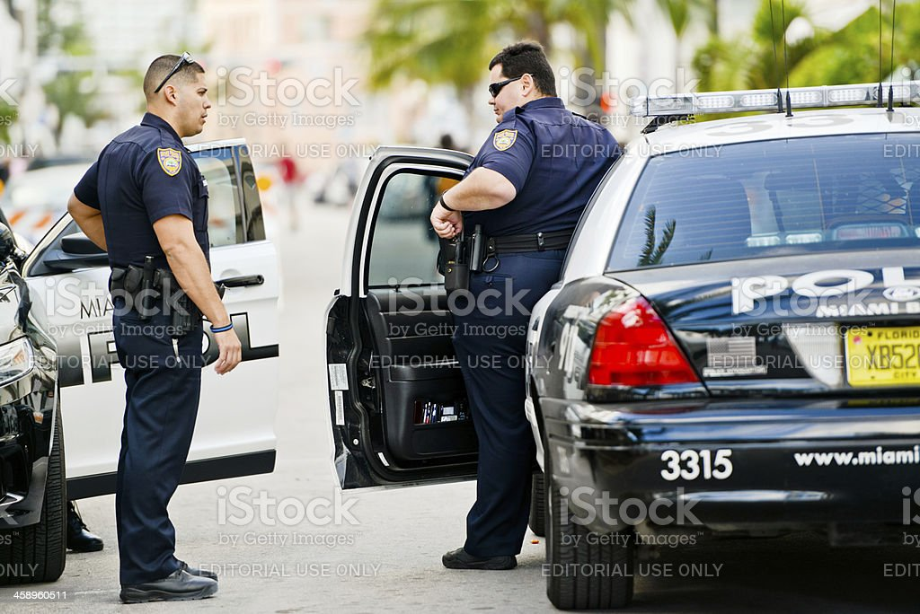 Miami Beach Policemen talking on the street royalty-free stock photo