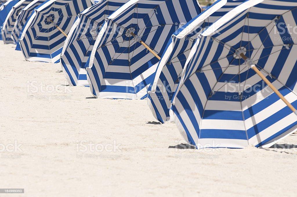 Miami Beach Rows of Blue and White Striped Umbrellas stock photo