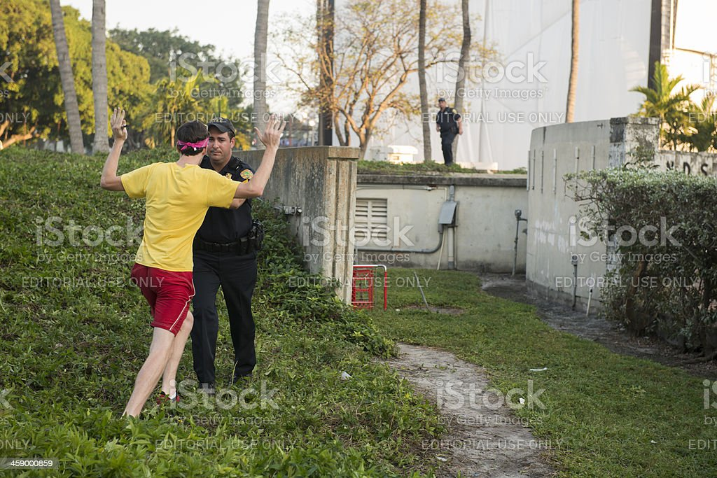 Miami Police Officer Gives Warning to Man Challenging Authority stock photo