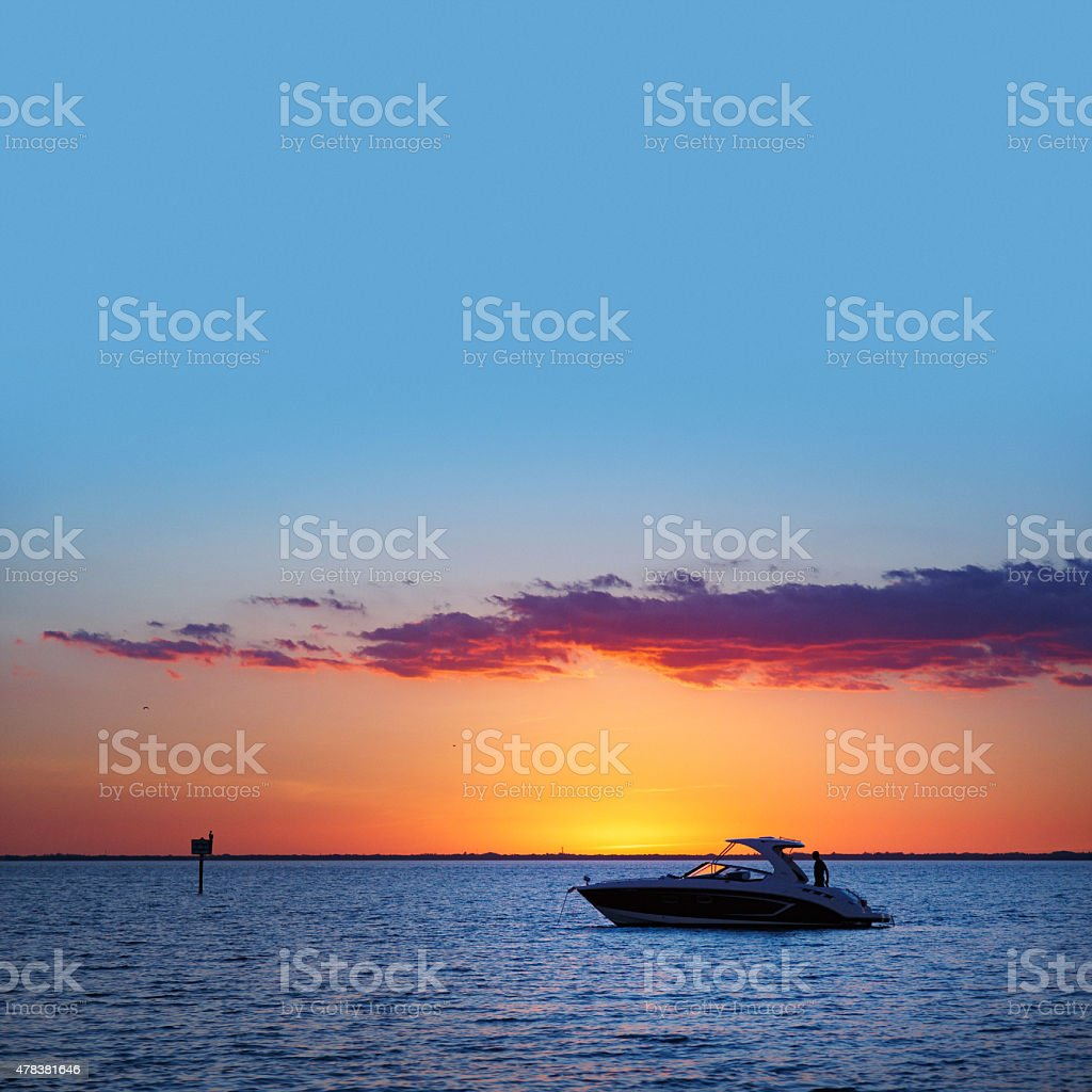 Miami small boat sunset stock photo