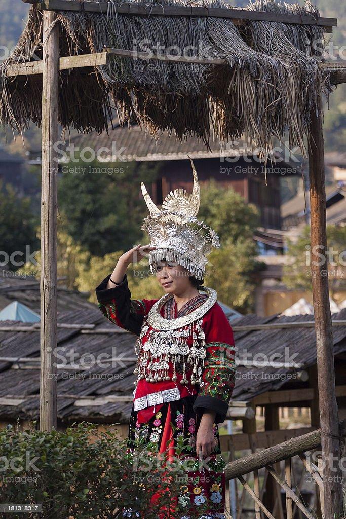 Miao girl standing in front of the door stock photo