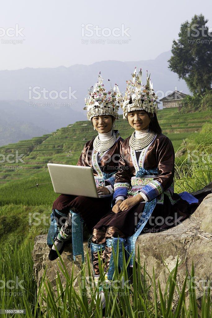 Miao Girls Use Laptop stock photo