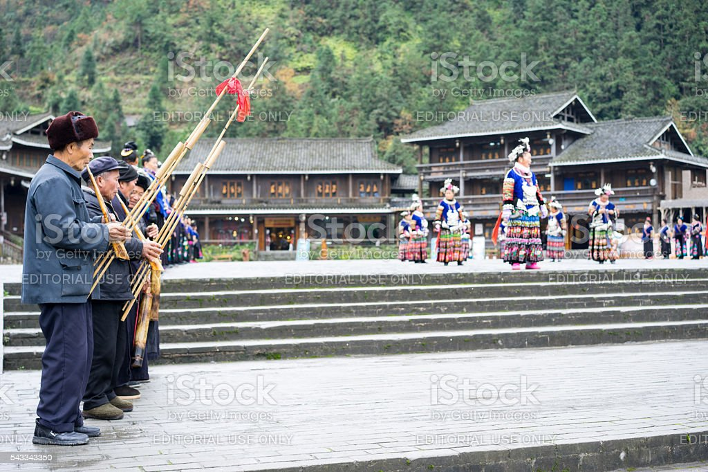 Miao people playing the reed-pipe wind instrument stock photo