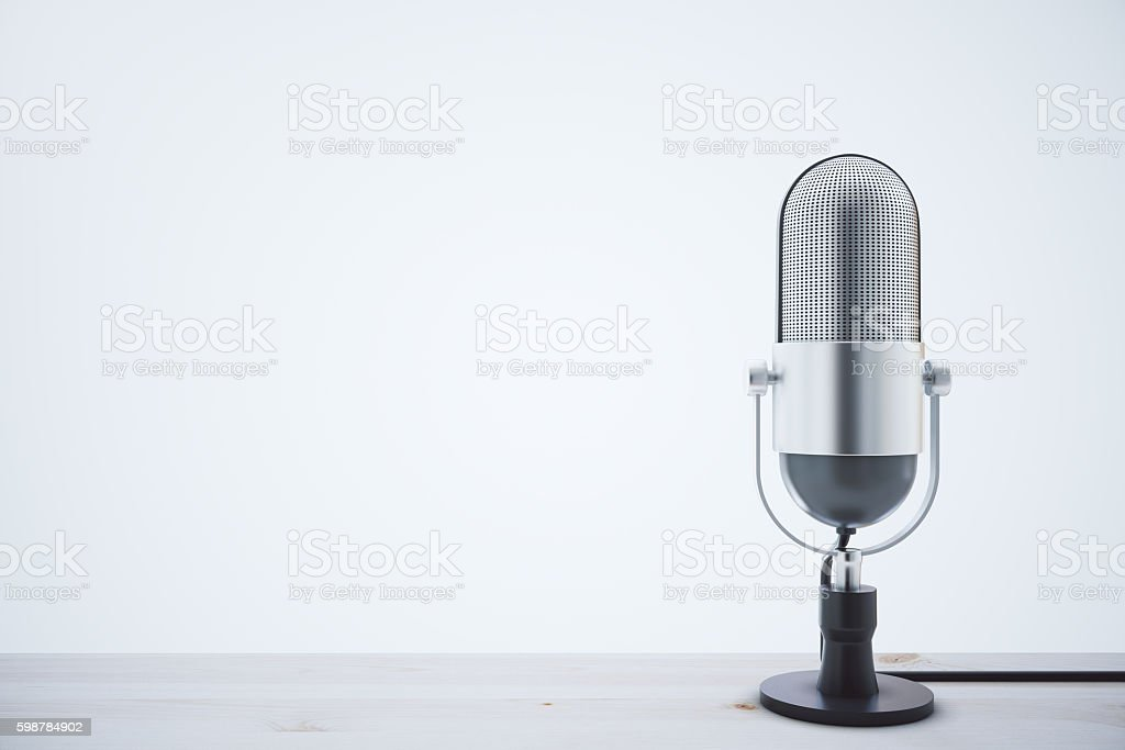 Mic on light wooden table stock photo