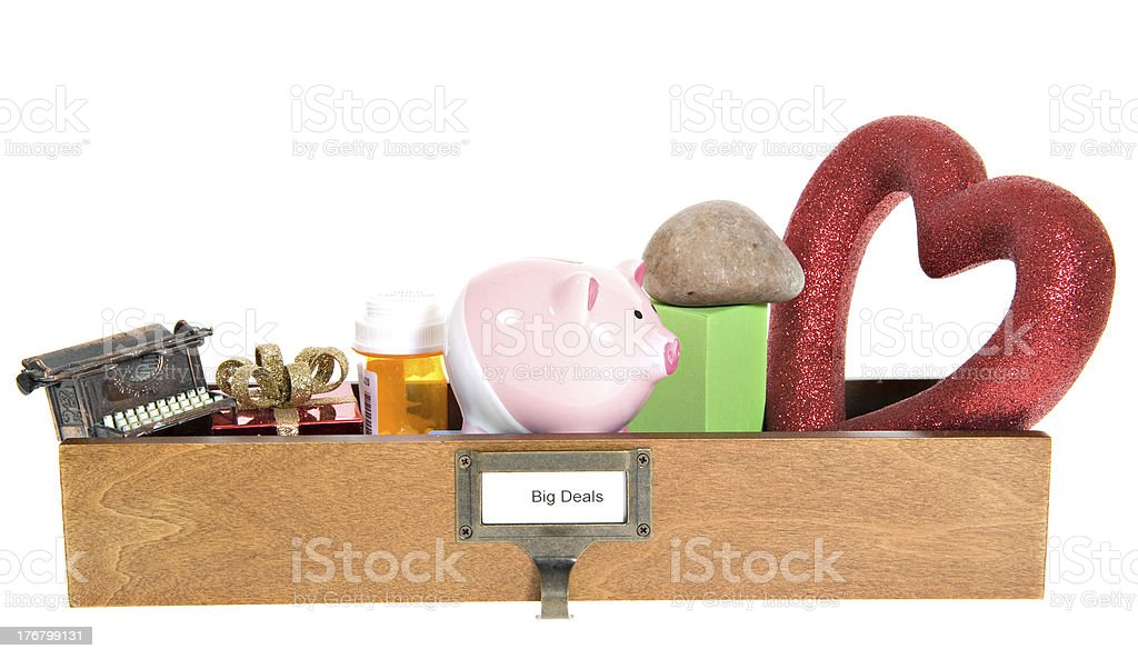 Micelanious Objects & Toys in a  Box Labeled 'BIG DEALS' royalty-free stock photo