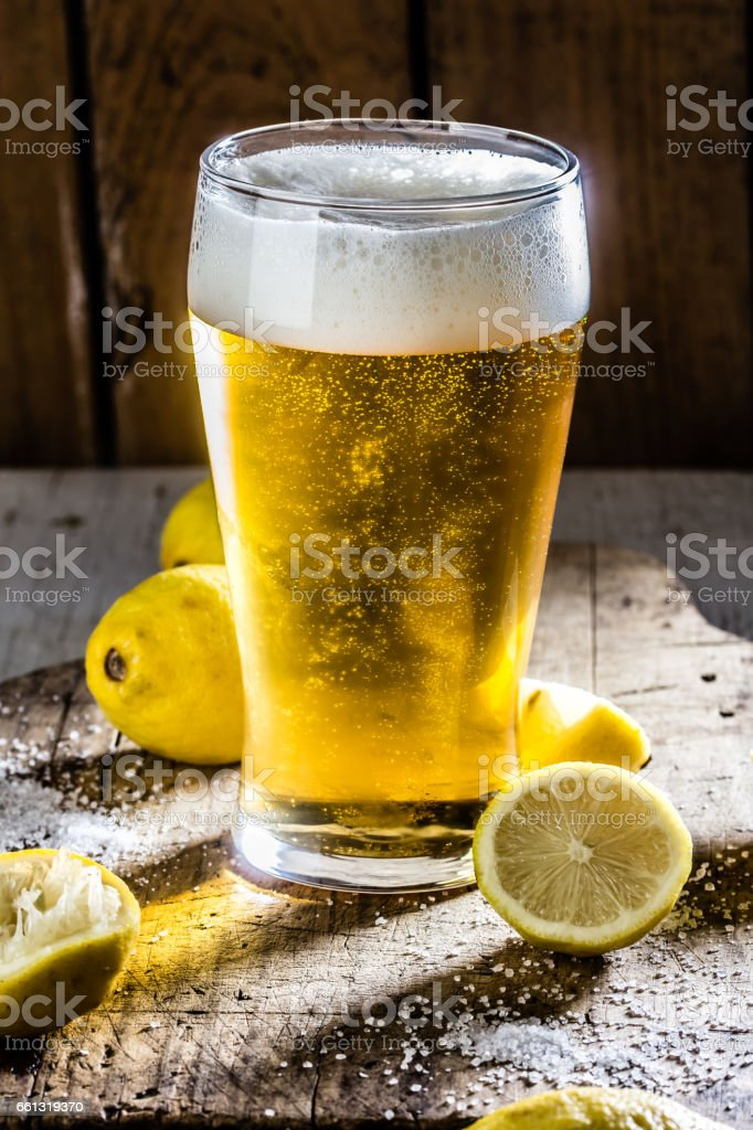 Michelada. Beer with lemon and salt. Ingredientes for tipical Latin American bear drink stock photo