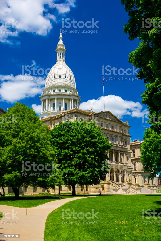 Michigan State Capitol Building with Trees and Deep Blue Sky stock photo