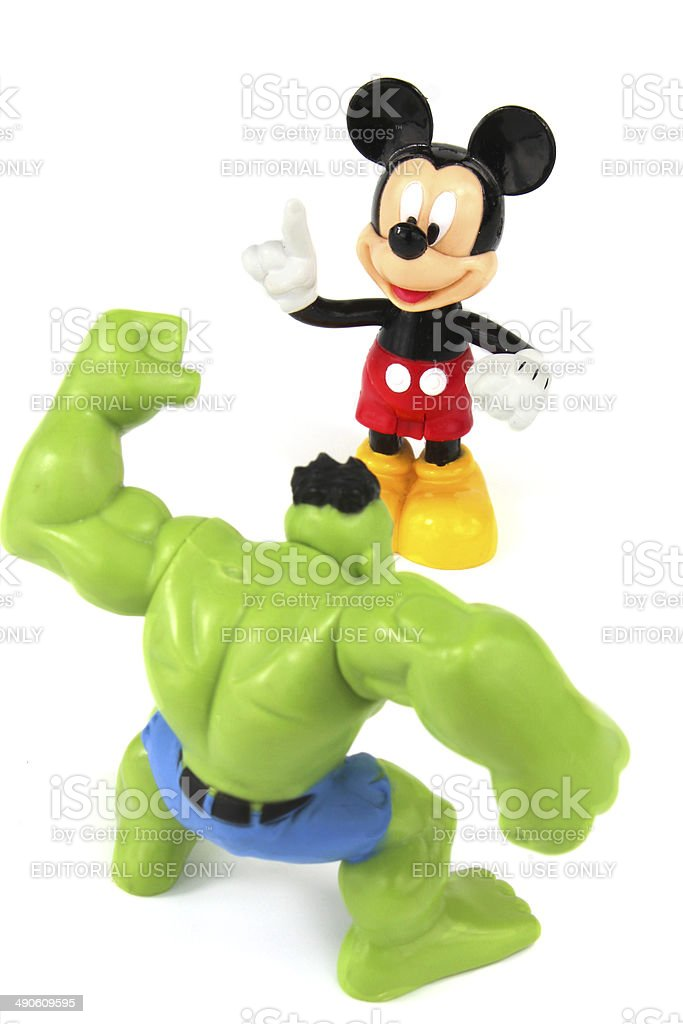 Mickey Mouse and The Hulk figurines stock photo