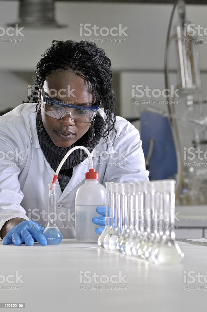 Microbiologist measures fluid stock photo