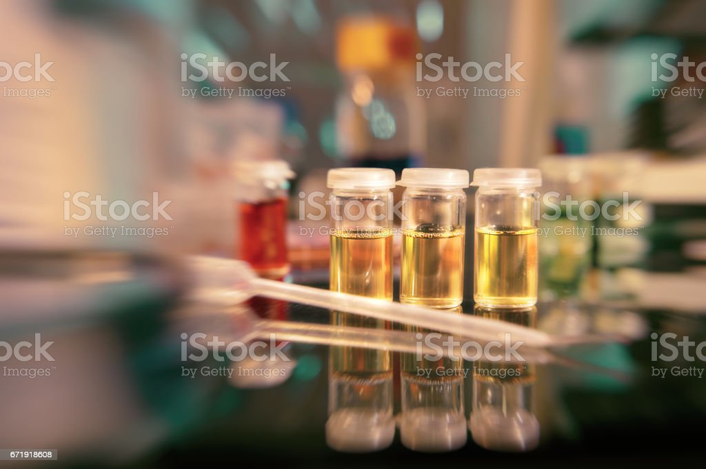 Microbiology background. Liquid bacterial cultures in plastic vials stock photo
