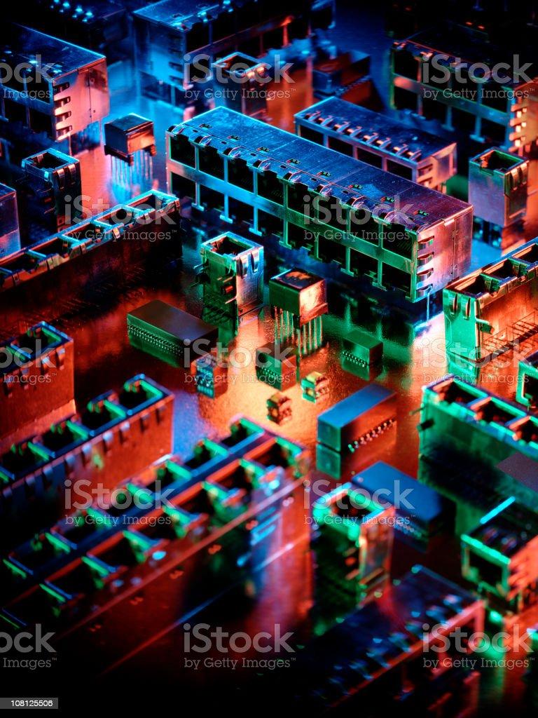 Microchip Circuit Board Resembling Mini City at Night royalty-free stock photo