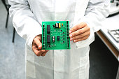 Microchip production factory. Computer expert. Manufacturing. Engineering. Professional. Technician.