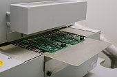 Microchip production factory. Technological process. Assembling the board. Chip. Manufacturing.