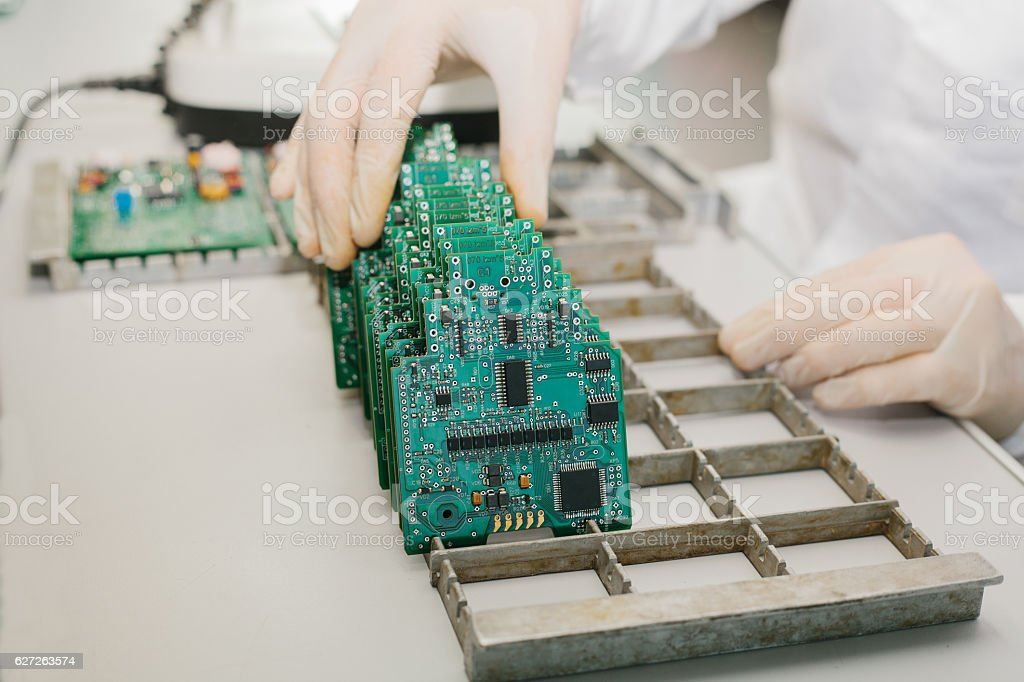 Microchip production factory. Technological process. Assembling the board. Computer expert. stock photo