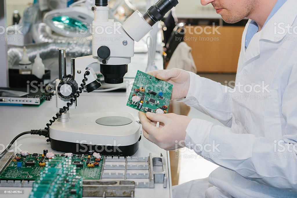 Microchip production factory. Technological process.Chip.  Technician. Computer expert. Manufacturing. Engineering. stock photo