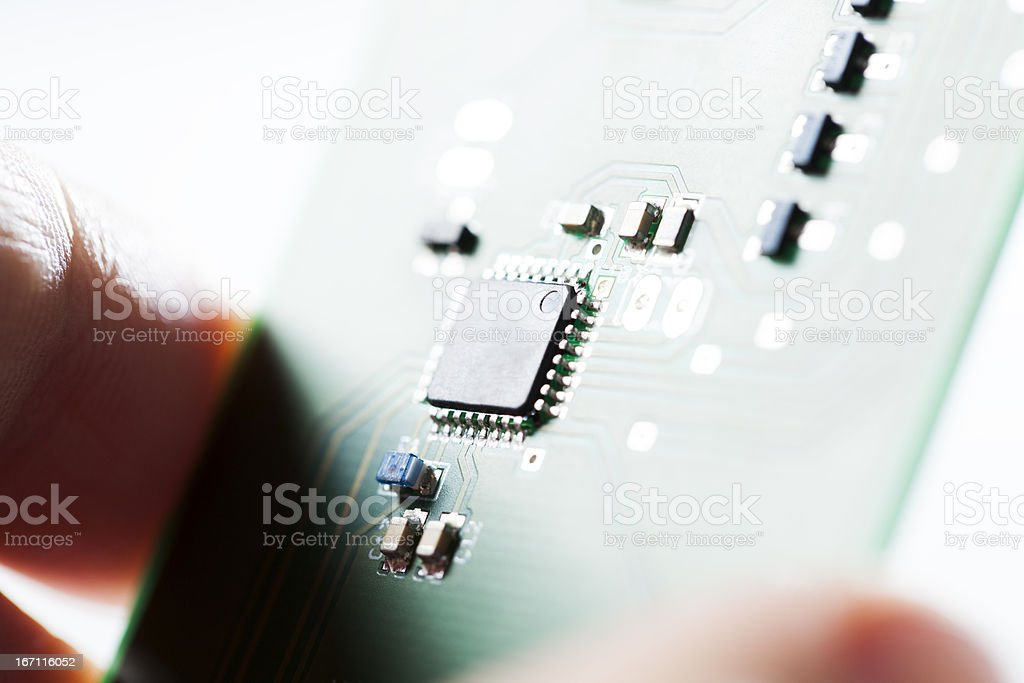Microcontroller - Technology In You Hand Circuit Board stock photo