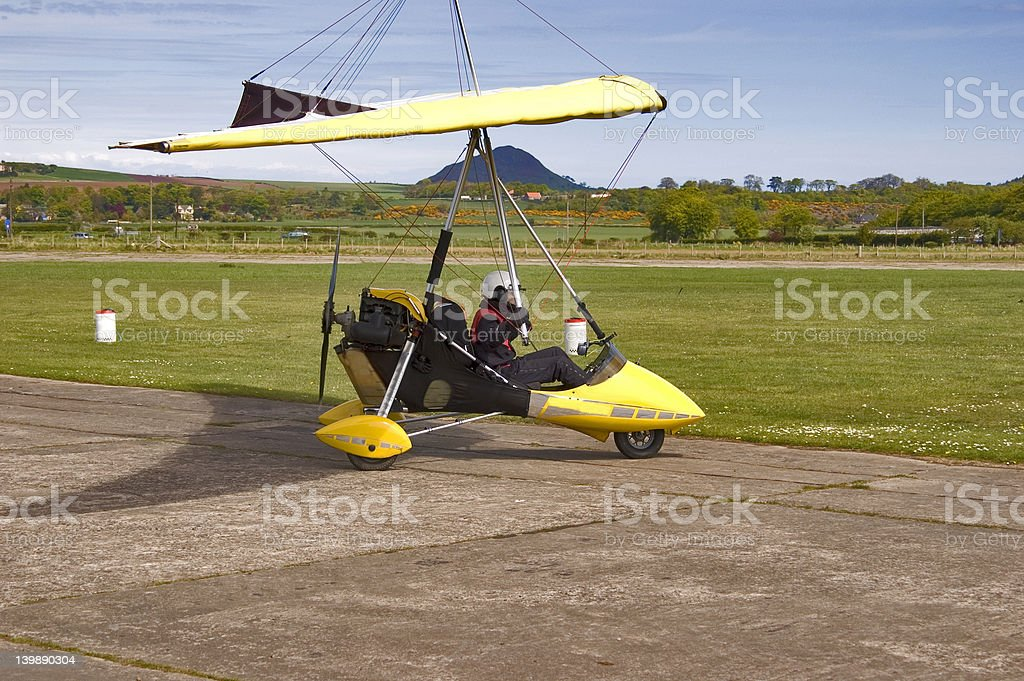 Microlight about to come off Runway stock photo
