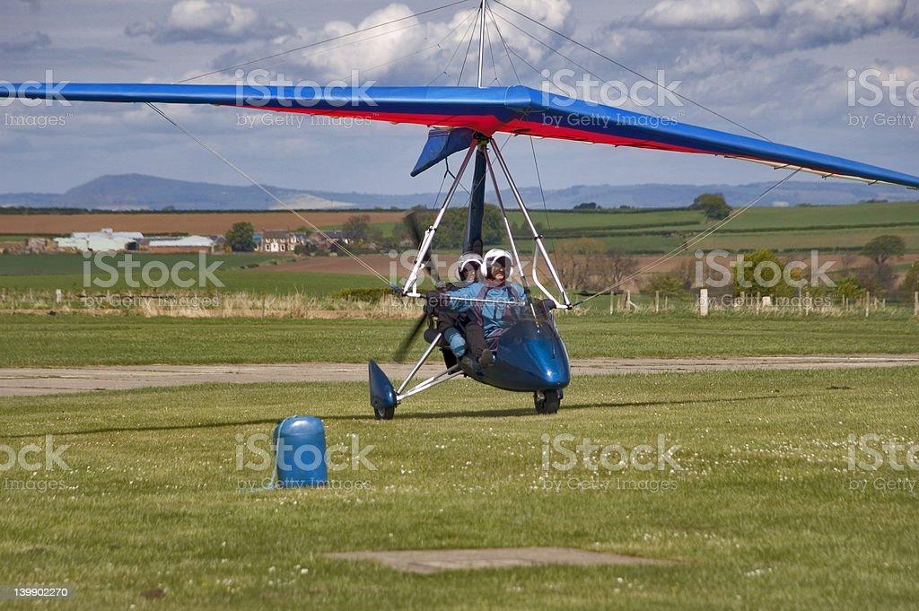 Microlight  aircraft taxiing  across grass stock photo