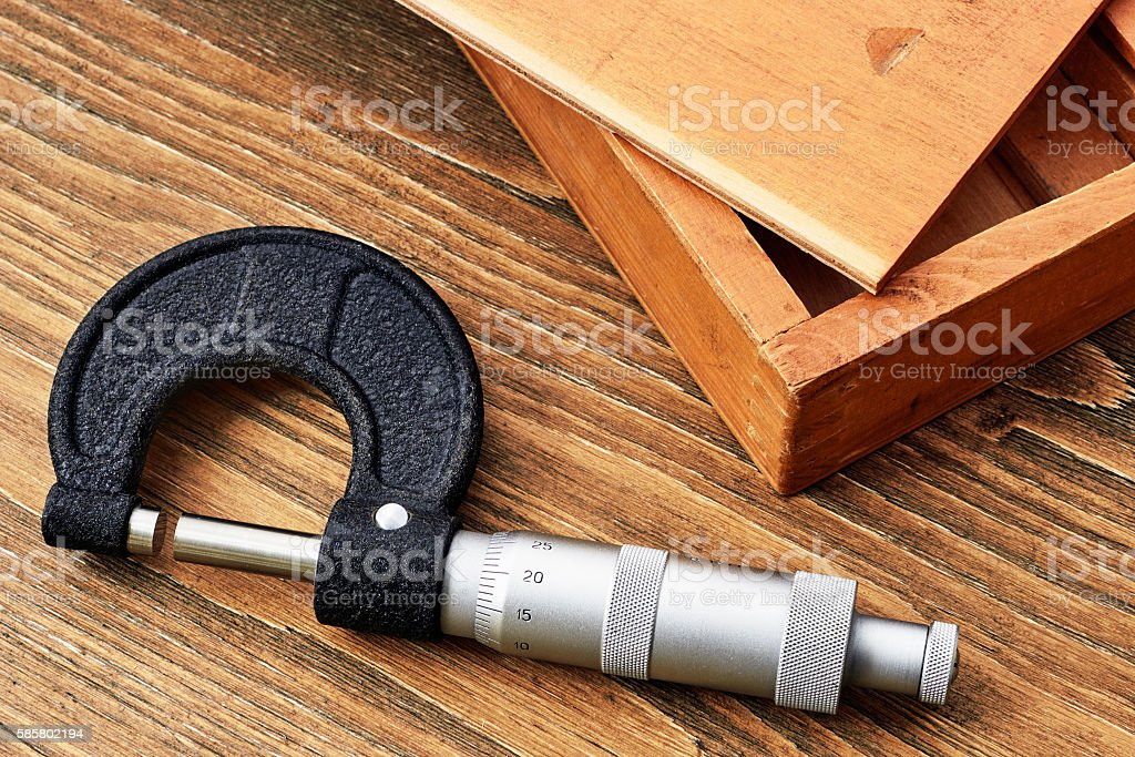 Micrometer at the wooden case stock photo