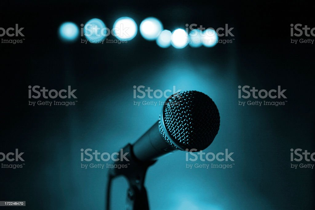 A microphone against a dark blue background royalty-free stock photo