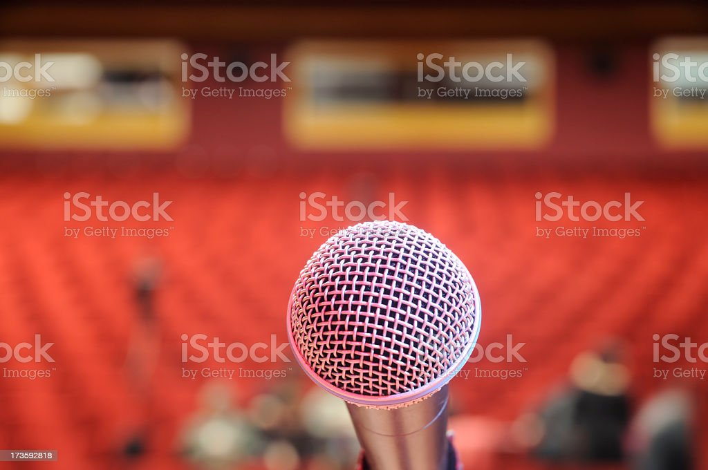 Microphone Against Audience royalty-free stock photo