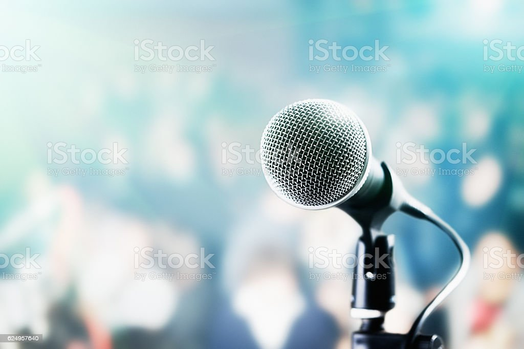 Microphone and defocused audience waiting for the show to begin stock photo