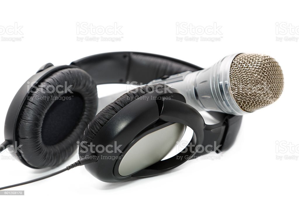 Microphone and ear-phones on a white background stock photo