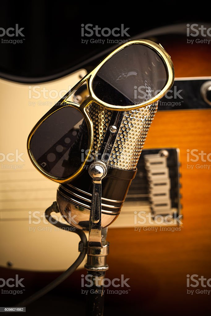 Microphone and Guitar with Sunglasses stock photo