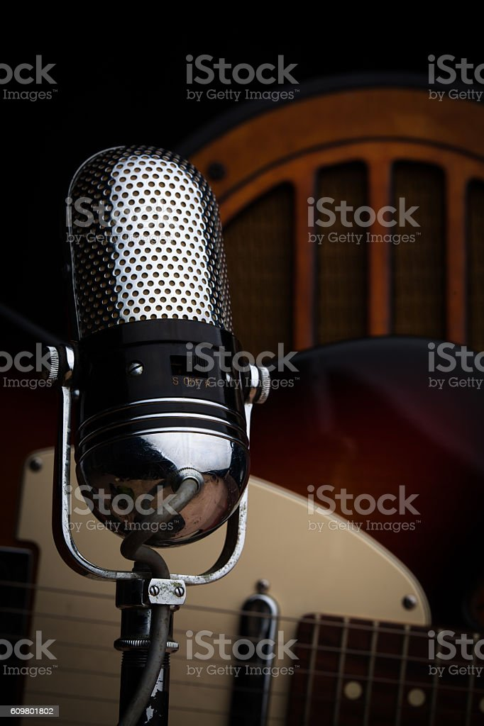 Microphone and Guitar with Vintage Radio stock photo