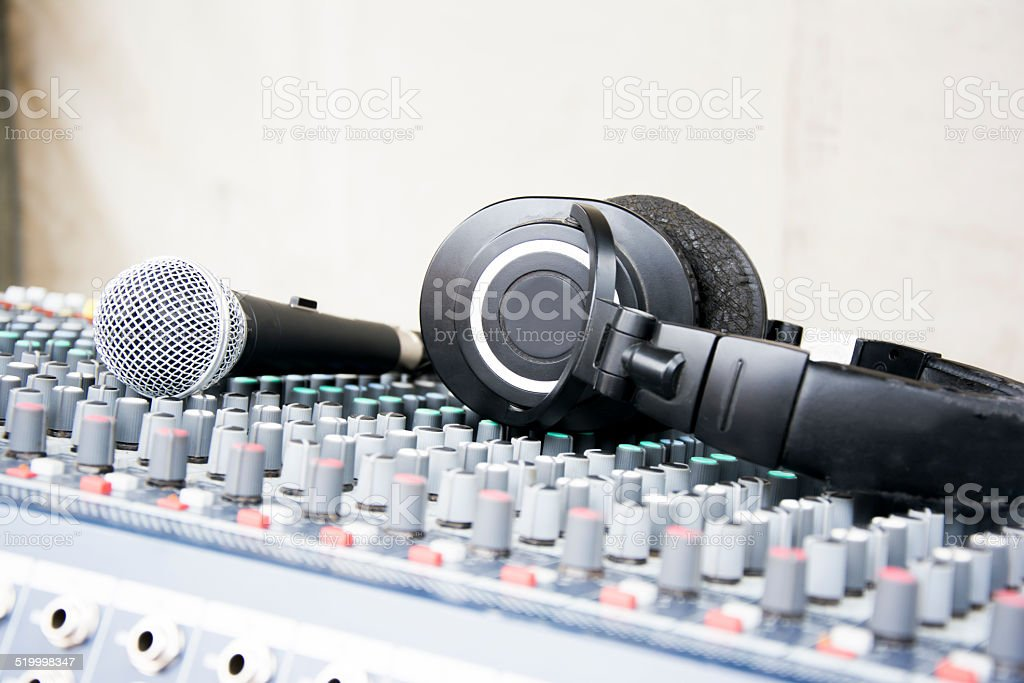 Microphone and headphones on a console stock photo