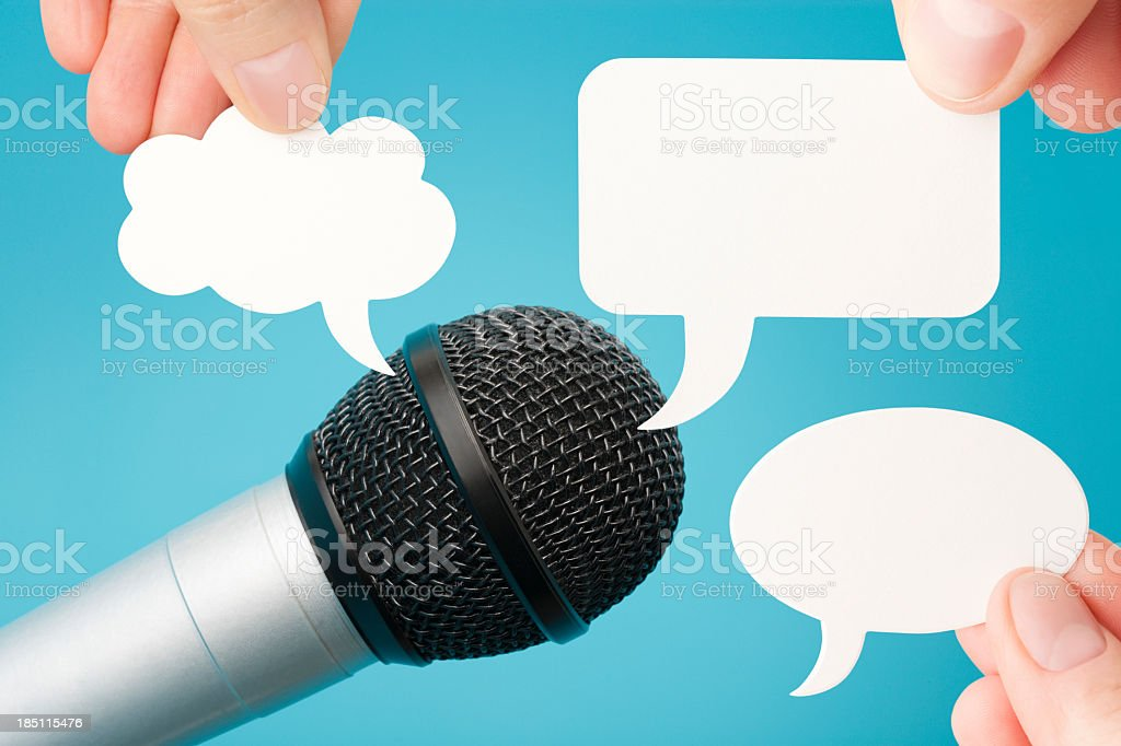 Microphone and three blank speech bubbles royalty-free stock photo