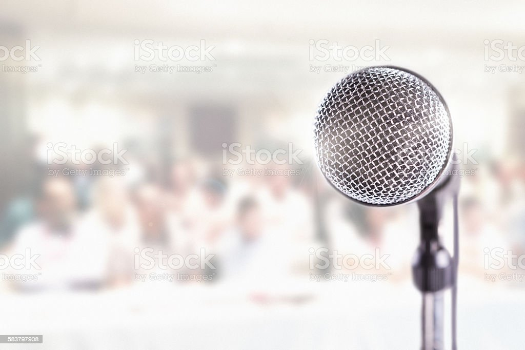 Microphone in close-up with background audience stock photo