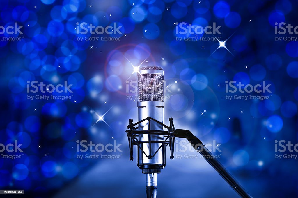 Microphone  in concert hall or karaoke stage stock photo