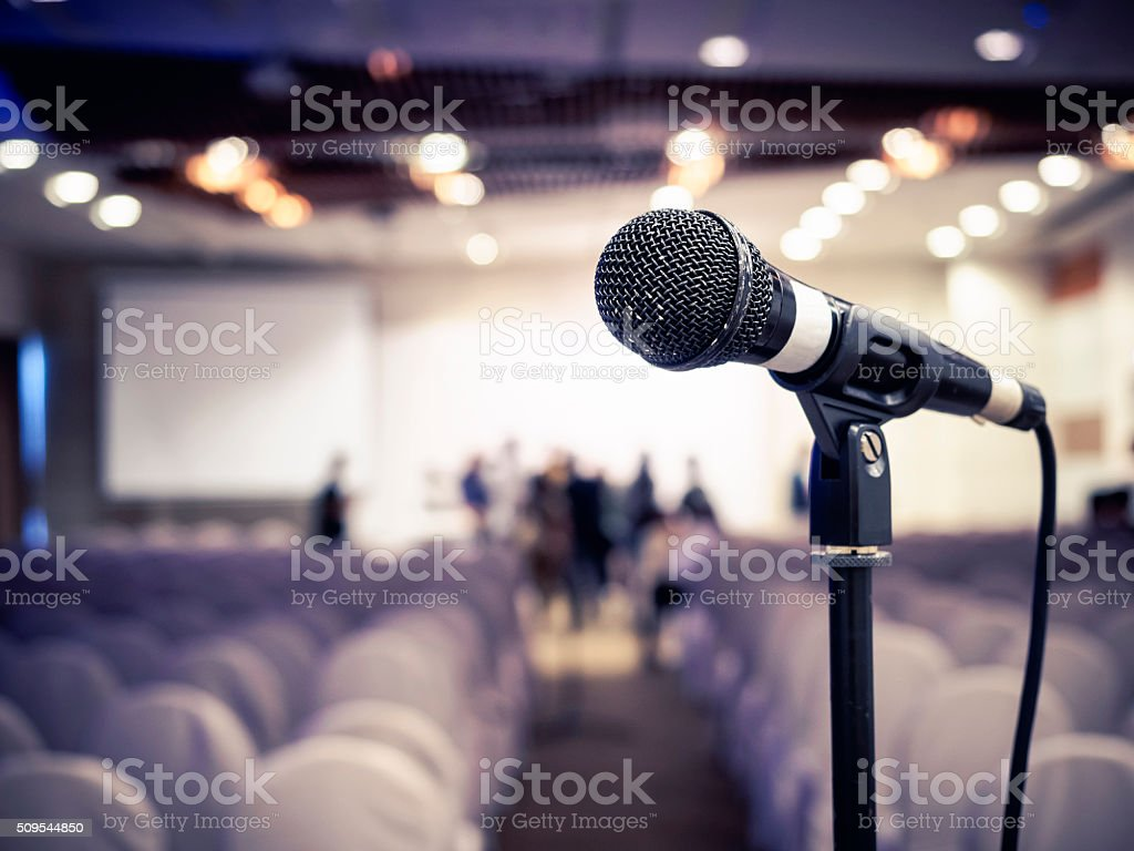 Microphone in Conference Seminar room Event Background stock photo