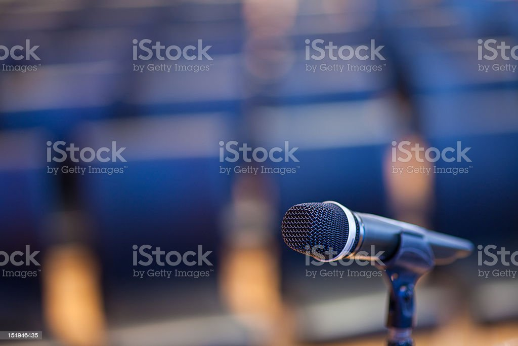 Microphone in Empty Convention Center royalty-free stock photo