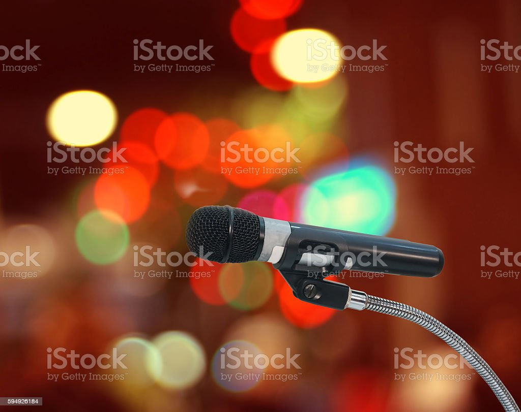 microphone in  hall with lights in background. with stock photo