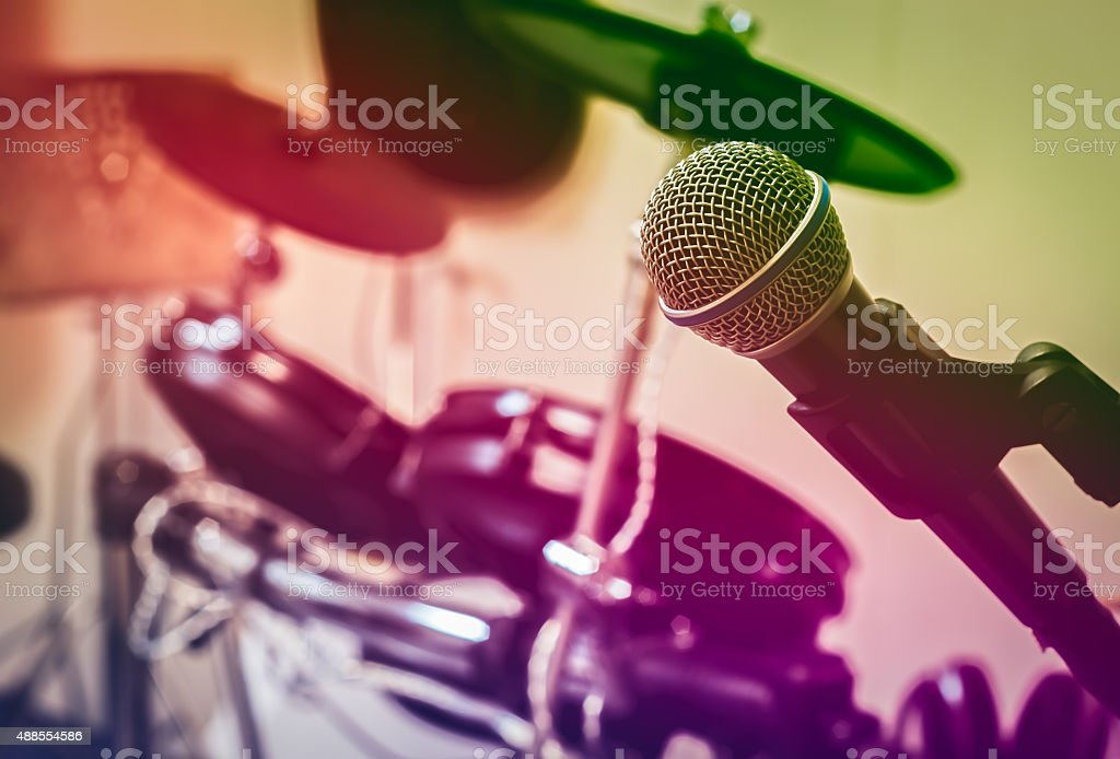 Microphone on blur drum background by vintage tone. stock photo