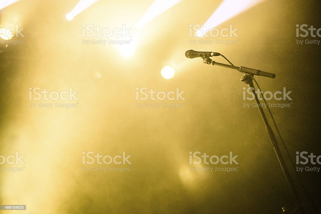 Microphone on empty stage waiting for a voice stock photo