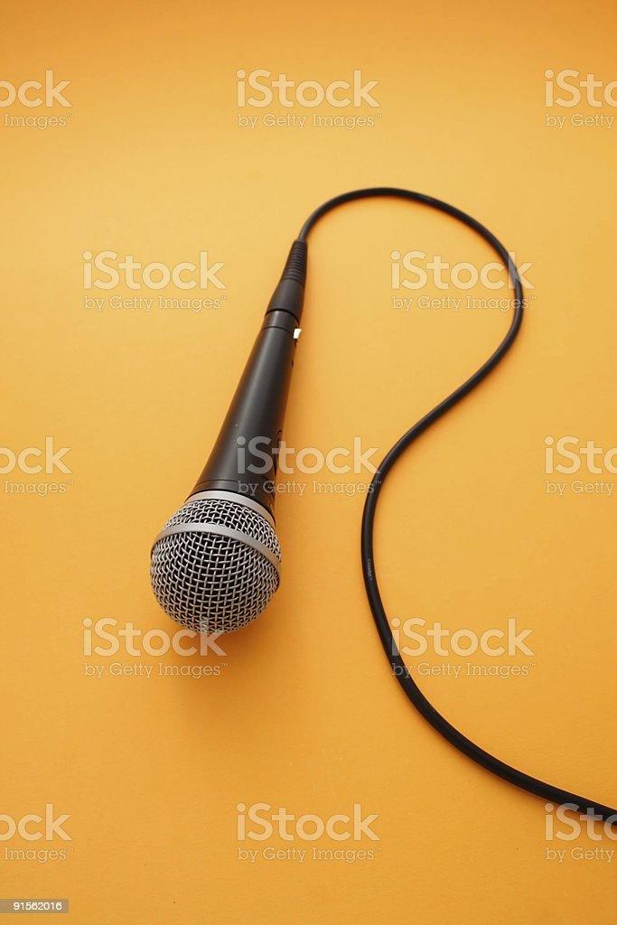 Microphone on orange background royalty-free stock photo