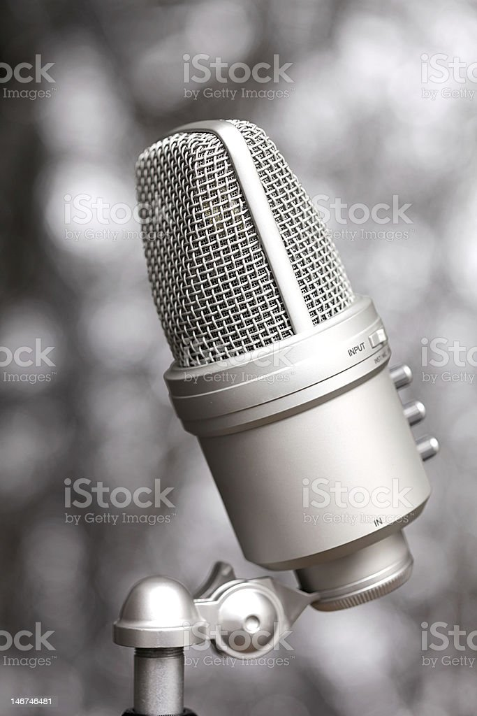 Microphone on silver background royalty-free stock photo